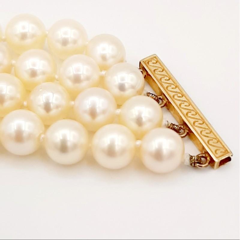 Bracelet 4 rangs de perles...